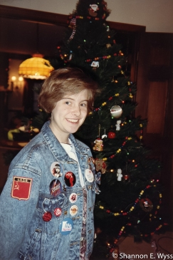 Me in 1990, a junior in high school wearing a jean jacket sporting many political patches and buttons, as well as a couple musical theater buttons